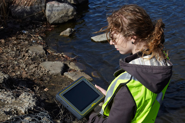A field technician uses a Trimble Kenai Rugged Tablet Computer. (Credit: Trimble)