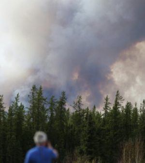 Smoke rises outside Fort McMurray. (Courtesy of Phys.org)